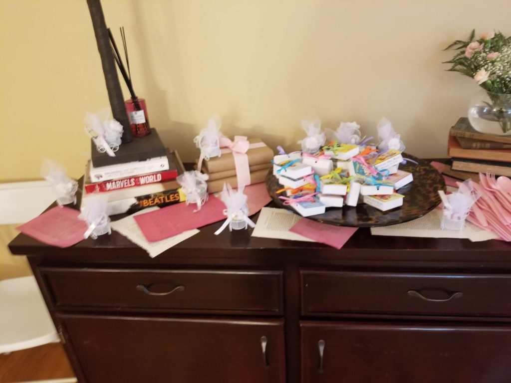 baby shower party favors: candy in little baby carriages and mini books