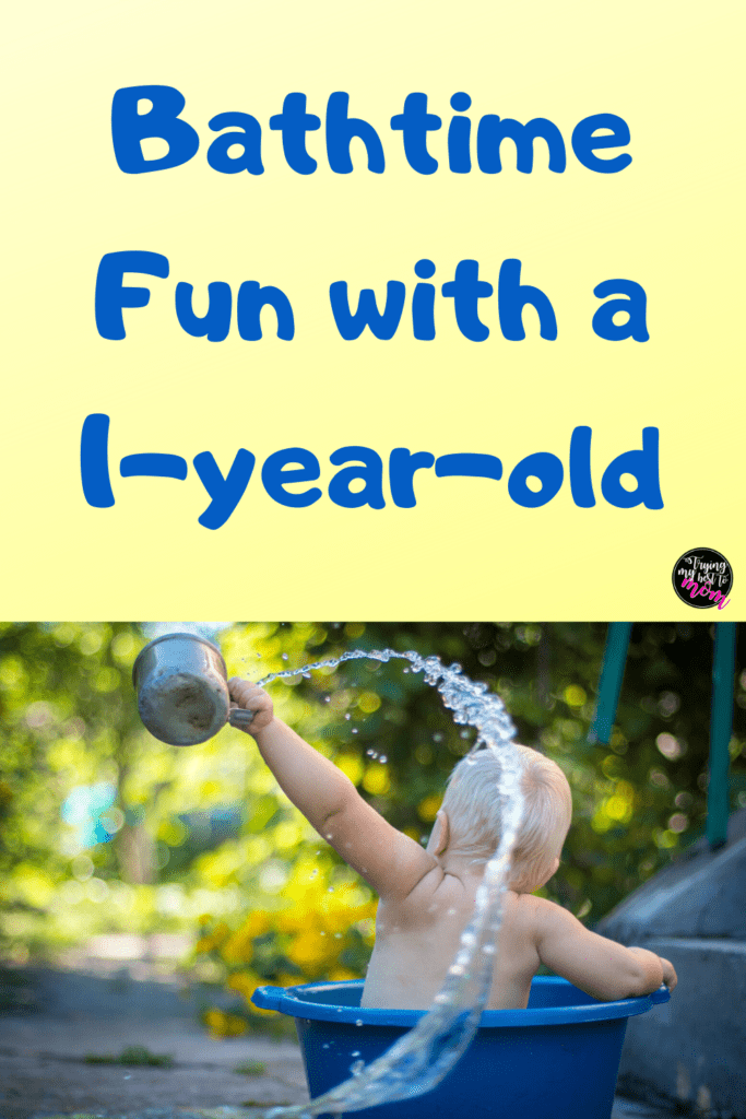 a baby throwing water out of a bathtub outside with text bathtime fun with a 1-year-old