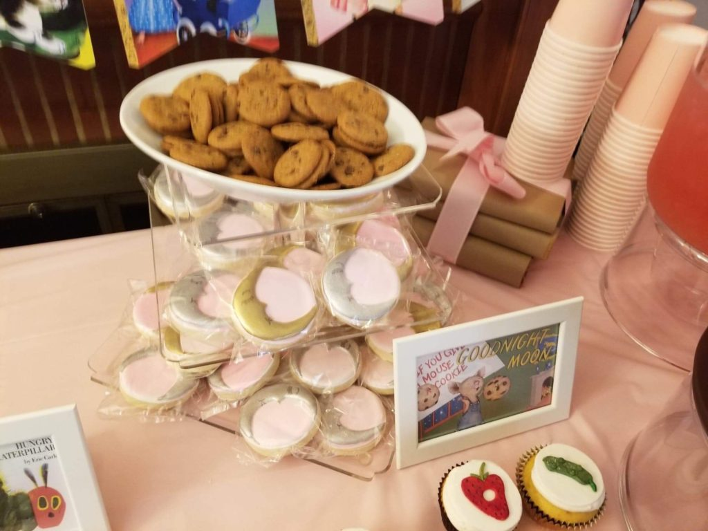 cookies and moon decorated cookies with a frame saying 'if you give a mouse a cookie' and 'goodnight moon' childrens books
