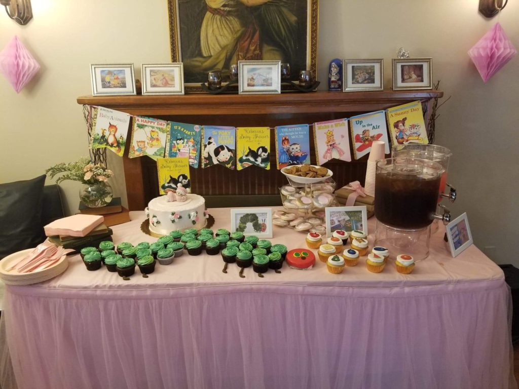 baby shower dessert table with childrens book themes