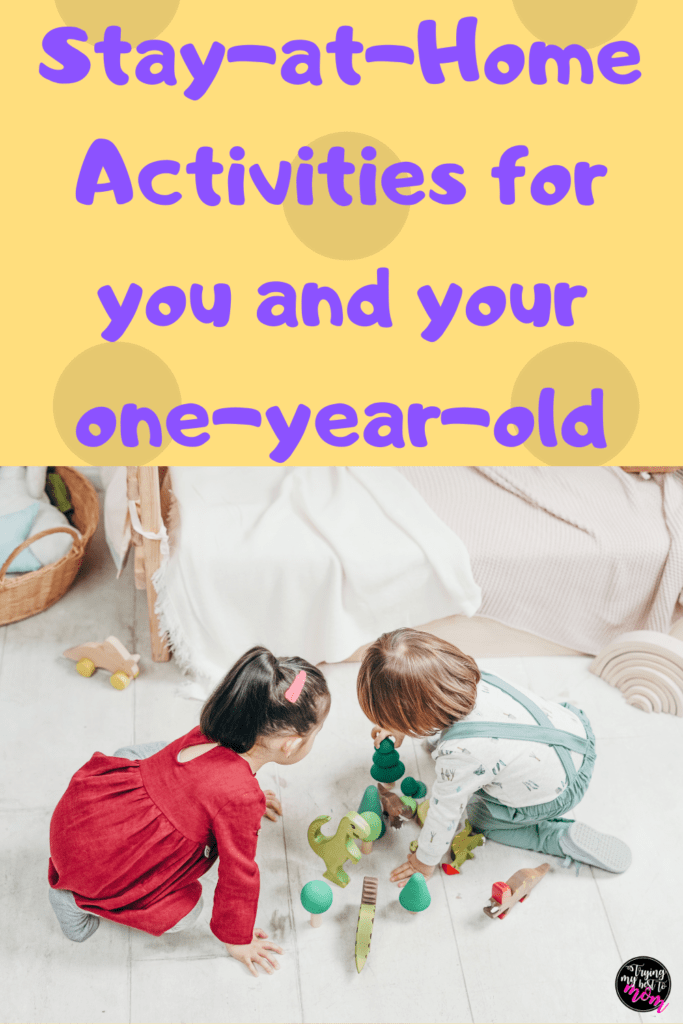 toddlers playing on floor with wooden toys with text stay at home activities for you and your one year old toddler