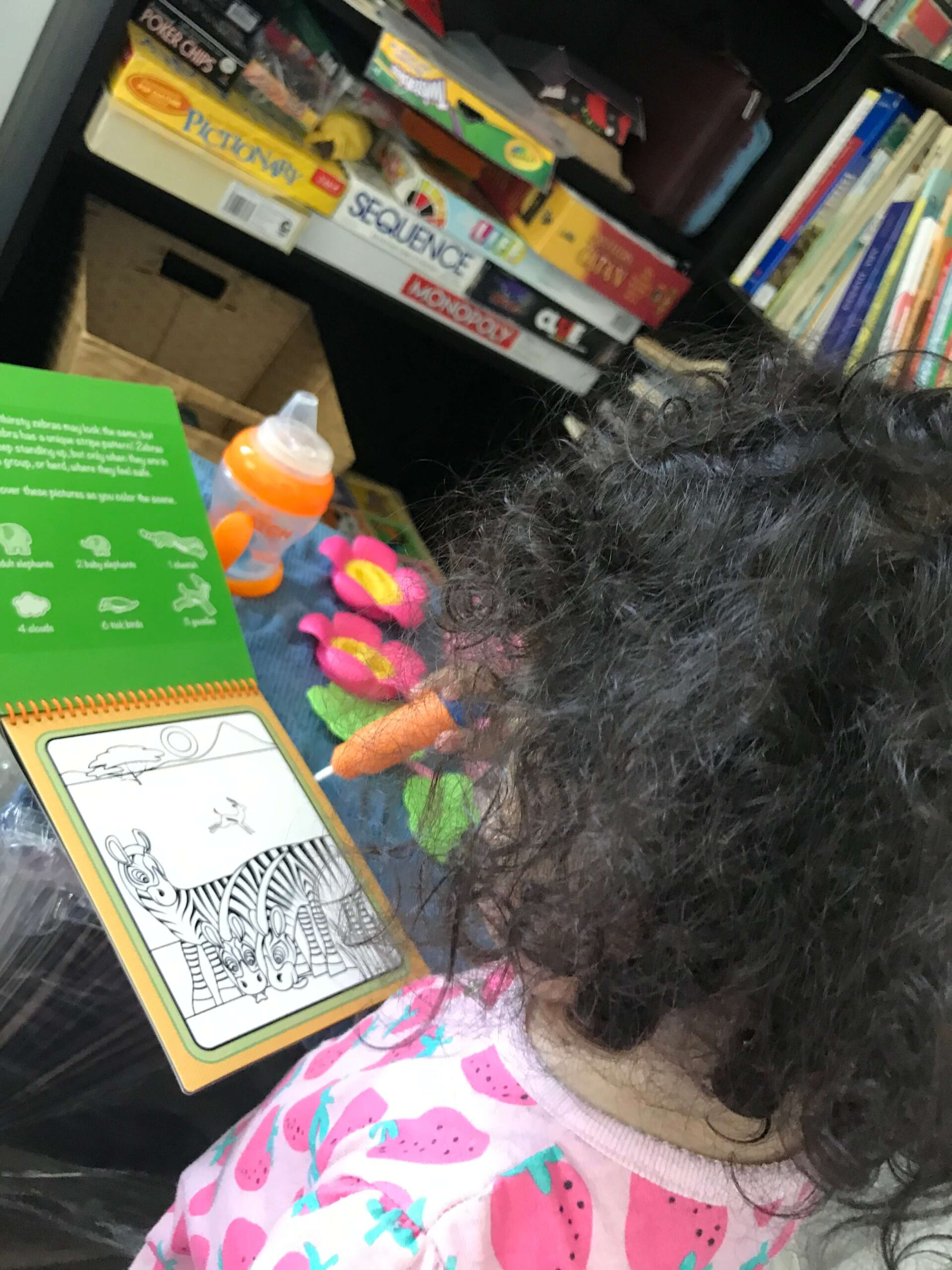 toddler coloring with water in her water wow magic coloring books