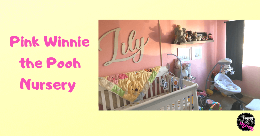 a pink pooh bear nursery with a white crib and text pink winnie the pooh nursery