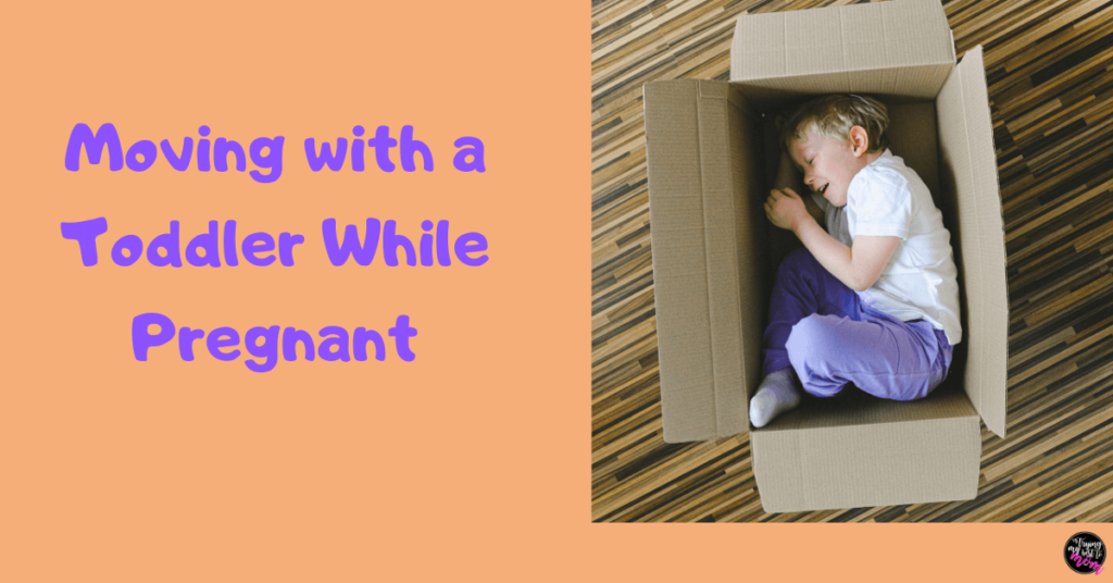 toddler in a cardboard box with text moving with a toddler while pregnant