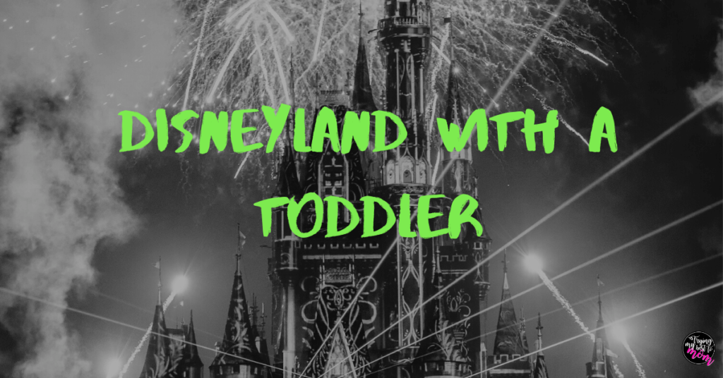 fireworks behind the sleeping beauty castle at disneyland with text disneyland with a toddler