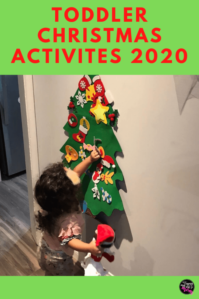 a toddler sticking a felt ornament on a felt christmas tree with text toddler christmas activities 2020