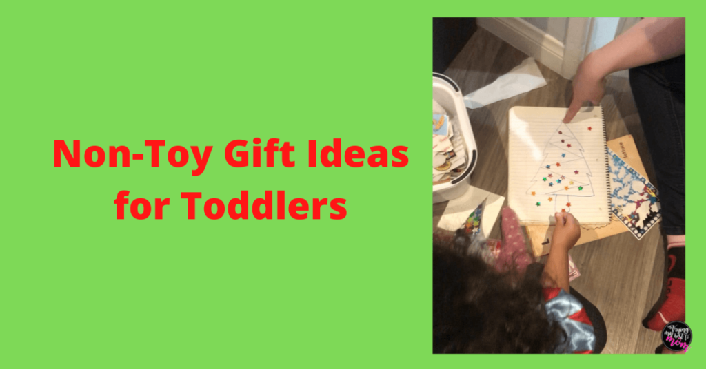 toddler putting stickers on paper with text non toy gift ideas for toddlers