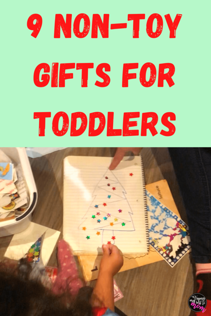 toddler putting stickers on a paper with text 9 non toy gifts for toddlers