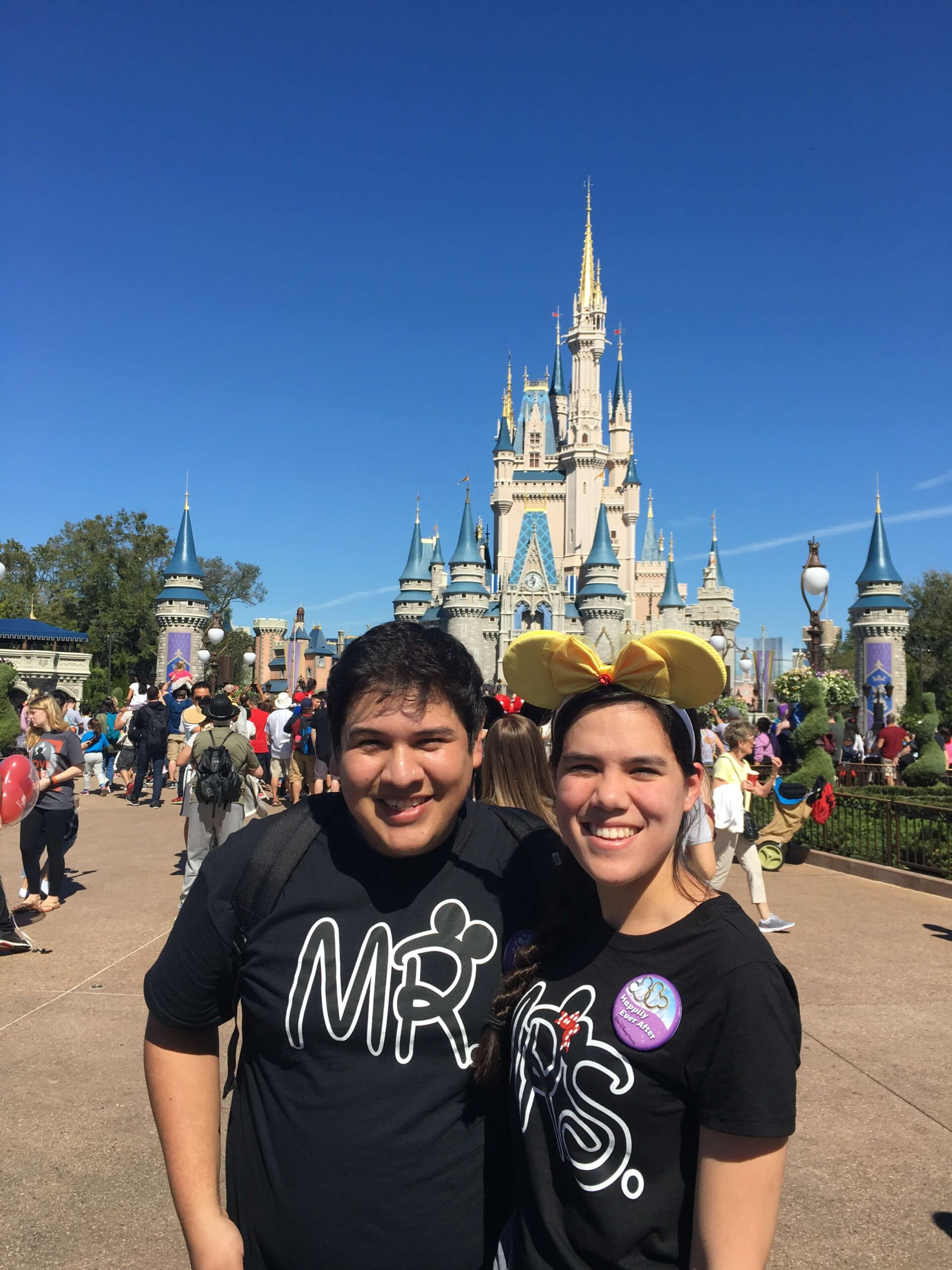 becky and my hubby in front of cinderella's castle