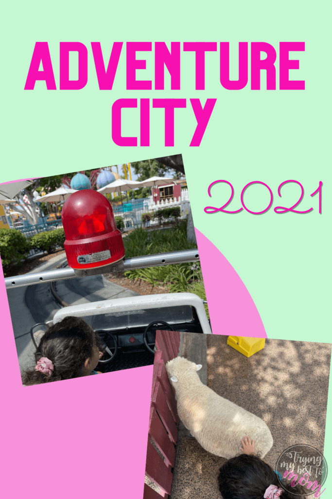 a toddler in a rescue vehicle at adventure city and petting a sheep, with text adventure city 2021